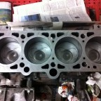 Engine reconditioning: cleaned pistons